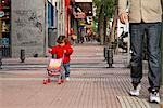Little Girl Walking With Father and Pushing Toy Carriage, Madrid, Spain                                                                                                                                  Stock Photo - Premium Rights-Managed, Artist: Mike Randolph            , Code: 700-02935431