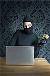 Woman Dressed in Black with Laptop                                                                                                                                                                       Stock Photo - Premium Rights-Managed, Artist: Apolonia                 , Code: 700-02935719