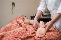 foot massage - Therapist massaging patient's foot Stock Photo - Premium Royalty-Freenull, Code: 685-02941919