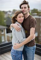 Couple hugging on roof deck Stock Photo - Premium Royalty-Freenull, Code: 635-02942678