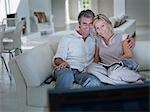 Couple watching television together Stock Photo - Premium Royalty-Free, Artist: Masterfile, Code: 635-02943131