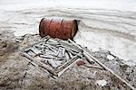 Fuel Barrel and Scrap Wood by an Abandoned RCMP Post and Post Office