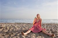 sandi model - Woman With a Lollipop Sitting on the Beach                                                                                                                                                               Stock Photo - Premium Rights-Managednull, Code: 700-02943261