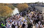 Crowds of pilgrims in white dress queueing to enter the water of the Jordan River during Christian Orthodox ceremony at Epiphany, Qasr el Yahud, Israel, Middle East                                     Stock Photo - Premium Rights-Managed, Artist: Robert Harding Images, Code: 841-02945838