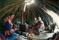 Sami man (Lapplander) inside laavo (tent), drinking moonshine, Finnmark, Norway, Scandinavia, Europe                                                                                                     Stock Photo - Premium Rights-Managednull, Code: 841-02945950