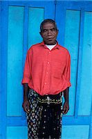 flores - Man in red shirt in Bajawa, Flores, Indonesia, Southeast Asia, Asia                                                                                                                                      Stock Photo - Premium Rights-Managednull, Code: 841-02946974