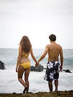 young couple at the beach holding hands Stock Photo - Premium Royalty-Freenull, Code: 640-02947706