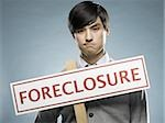man holding a foreclosure sign Stock Photo - Premium Royalty-Freenull, Code: 640-02948690