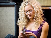 woman text messaging Stock Photo - Premium Royalty-Freenull, Code: 640-02948834