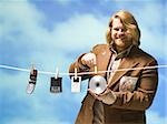 man hanging tech devices on a clothesline Stock Photo - Premium Royalty-Free, Artist: Hiep Vu, Code: 640-02949219