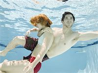 man saving a woman from drowning Stock Photo - Premium Royalty-Freenull, Code: 640-02951420
