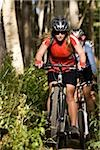 mountain bikers riding down a trail Stock Photo - Premium Royalty-Free, Artist: Cusp and Flirt, Code: 640-02952175