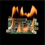 computer chip on fire Stock Photo - Premium Royalty-Free, Artist: Gary Gerovac, Code: 640-02952201
