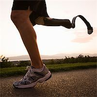 jogger with a right below knee prosthetic running leg Stock Photo - Premium Royalty-Freenull, Code: 640-02952345