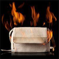 purse on fire Stock Photo - Premium Royalty-Freenull, Code: 640-02953483