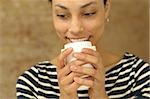 Smiling young woman holding plastic cup Stock Photo - Premium Royalty-Freenull, Code: 628-02953516