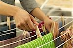 Woman hanging washing on clothes horse Stock Photo - Premium Royalty-Freenull, Code: 628-02953520