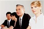 Four businesspeople in conference room, Bavaria, Germany Stock Photo - Premium Royalty-Free, Artist: Blend Images, Code: 628-02953586