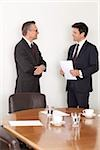 Two businessmen talking in conference room, Munich, Bavaria, Germany Stock Photo - Premium Royalty-Free, Artist: Blend Images, Code: 628-02953594