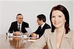 Three businesspeople in conference room, Bavaria, Germany Stock Photo - Premium Royalty-Free, Artist: Blend Images, Code: 628-02953604
