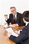 Two businessmen talking in conference room, Munich, Bavaria, Germany Stock Photo - Premium Royalty-Free, Artist: Cultura RM, Code: 628-02953627