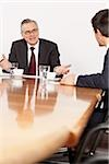 Two businessmen talking in conference room, Munich, Bavaria, Germany Stock Photo - Premium Royalty-Free, Artist: Robert Harding Images, Code: 628-02953637
