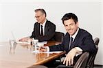 Two businessmen talking in conference room, Munich, Bavaria, Germany Stock Photo - Premium Royalty-Free, Artist: Robert Harding Images, Code: 628-02953643