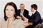 Three businesspeople in conference room, Bavaria, Germany Stock Photo - Premium Royalty-Free, Artist: Blend Images, Code: 628-02953646