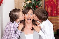preteen kissing - Boy and girl kissing their mother Stock Photo - Premium Royalty-Freenull, Code: 628-02953680