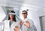 Woman and man with head-mounted displays Stock Photo - Premium Royalty-Free, Artist: George Contorakes, Code: 628-02953814