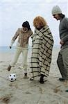 Three Friends playing Football at the Beach - Fun - Game - Season - Coldness Stock Photo - Premium Royalty-Freenull, Code: 628-02954679