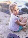 Young Girl Sitting on Rocks Near the Ocean Stock Photo - Premium Rights-Managed, Artist: Natasha Nicholson        , Code: 700-02954822