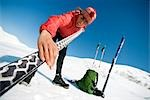 Female skier prepares skis for cross-country skiing in the Center Ridge area of Turnagain Pass of Chugach National Forest, Alaska                                                                        Stock Photo - Premium Rights-Managed, Artist: AlaskaStock              , Code: 854-02954905