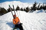 Female skier enjoys a sunny break during while ski touring on Center Ridge in the Turnagain Pass area of Chugach National Forest, Alaska                                                                 Stock Photo - Premium Rights-Managed, Artist: AlaskaStock              , Code: 854-02954908