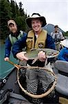 Man holding Dolly Varden caught drift fishing Kenai River Kenai Peninsula Alaska Summer                                                                                                                  Stock Photo - Premium Rights-Managed, Artist: AlaskaStock              , Code: 854-02955001