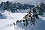 Mountaineer climbing on narrow ridge in Kichatna Mtns Denali National Park Interior Alaska Winter