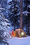 A tent is set up in the woods with Christmas lights and stocking near Anchorage, Alaska                                                                                                                  Stock Photo - Premium Rights-Managed, Artist: AlaskaStock              , Code: 854-02955069