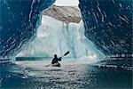 Sea Kayaker paddles through an ice cave amongst giant icebergs near Bear Glacier in Resurrection Bay near Seward, Alaska                                                                                 Stock Photo - Premium Rights-Managed, Artist: AlaskaStock              , Code: 854-02955125
