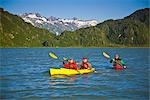 Kayakers on Big River Lakes with Tordillo Mountains in the background in the Redoubt Bay State Critical Habitat Area during Summer in Southcentral Alaska                                                Stock Photo - Premium Rights-Managed, Artist: AlaskaStock              , Code: 854-02955132