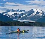 Sea kayaker in Inside Passage near Juneau viewing Mendenhall Glacier Coast Mtns Southeast AK Summer                                                                                                      Stock Photo - Premium Rights-Managed, Artist: AlaskaStock              , Code: 854-02955150