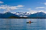 Sea kayaker in Inside Passage near Juneau viewing Mendenhall Glacier Coast Mtns Southeast AK Summer                                                                                                      Stock Photo - Premium Rights-Managed, Artist: AlaskaStock              , Code: 854-02955151