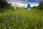 Woman walking in grass in Kenai Mountains along Lost Lake Trail near Seward, Alaska during Summer                                                                                                        Stock Photo - Premium Rights-Managed, Artist: AlaskaStock              , Code: 854-02955165