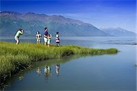 Family hiking in meadow near Bird Point along Turnagain Arm, with Kenai Mtns background, AK Summer                                                                                                       Stock Photo - Premium Rights-Managednull, Code: 854-02955183