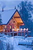 Log Cabin in the woods decorated with Christmas lights at twilight near Fairbanks, Alaska during Winter                                                                                                  Stock Photo - Premium Rights-Managednull, Code: 854-02955486