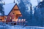 Log Cabin in the woods decorated with Christmas lights at twilight near Fairbanks, Alaska during Winter                                                                                                  Stock Photo - Premium Rights-Managed, Artist: AlaskaStock, Code: 854-02955487