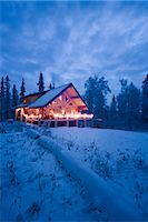 Log Cabin in the woods decorated with Christmas lights at twilight near Fairbanks, Alaska during Winter                                                                                                  Stock Photo - Premium Rights-Managednull, Code: 854-02955488
