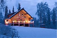 Log Cabin in the woods decorated with Christmas lights at twilight near Fairbanks, Alaska during Winter                                                                                                  Stock Photo - Premium Rights-Managednull, Code: 854-02955489