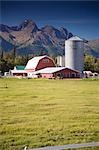 Horse grazing in pasture w/old Colony barn & farm below Chugach Mountains Mat-Su Valley Alaska Summer                                                                                                    Stock Photo - Premium Rights-Managed, Artist: AlaskaStock              , Code: 854-02955546
