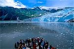 Vistors stand on bow of a boat tour to view Aialik Glacier in Aialik Bay in Southcentral Alaska during Summer                                                                                            Stock Photo - Premium Rights-Managed, Artist: AlaskaStock              , Code: 854-02955627