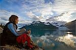 Woman overlooking Surprise Glacier at sunset Harriman Fjord PWS Southcentral Alaska summer                                                                                                               Stock Photo - Premium Rights-Managed, Artist: AlaskaStock              , Code: 854-02956096